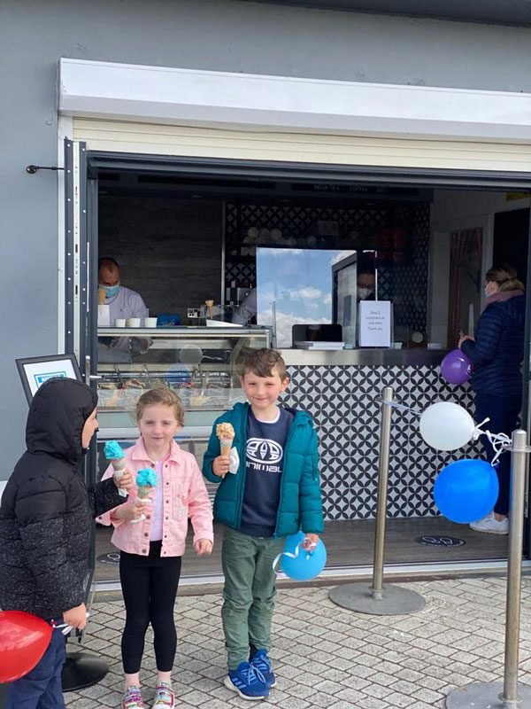 children getting ice cream st ellis bay llanelli